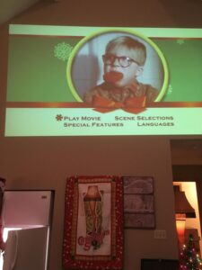 "Projection of ""A Christmas Story"" and leg lamp quilt hanging below (created by the mother-in-law of the party)"